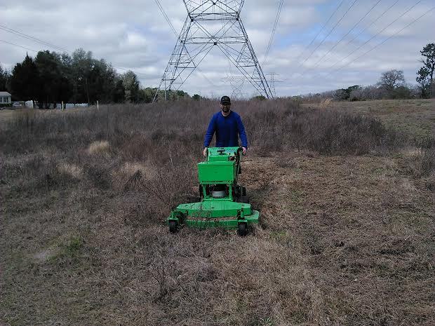 Completed mower cutting tall FLA grass